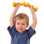 4 years old boy with dumbbells isolated on white