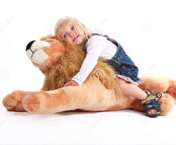 http://www.dreamstime.com/royalty-free-stock-image-little-girl-leaning-toy-lion-image20003666